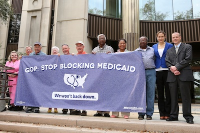 MoveOn members and Anna Galland outside the Louisiana court house